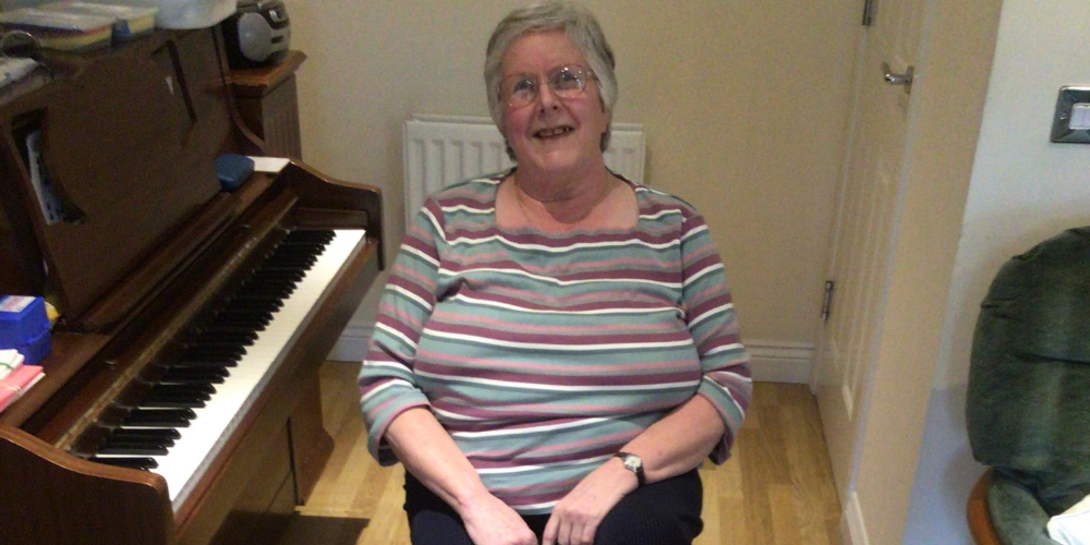 Mary using foot pedal from the COVID Activity Packs provided by Stockport Moving Together