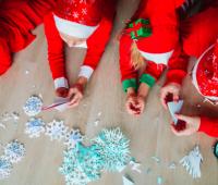 Family making Christmas snowflake crafts