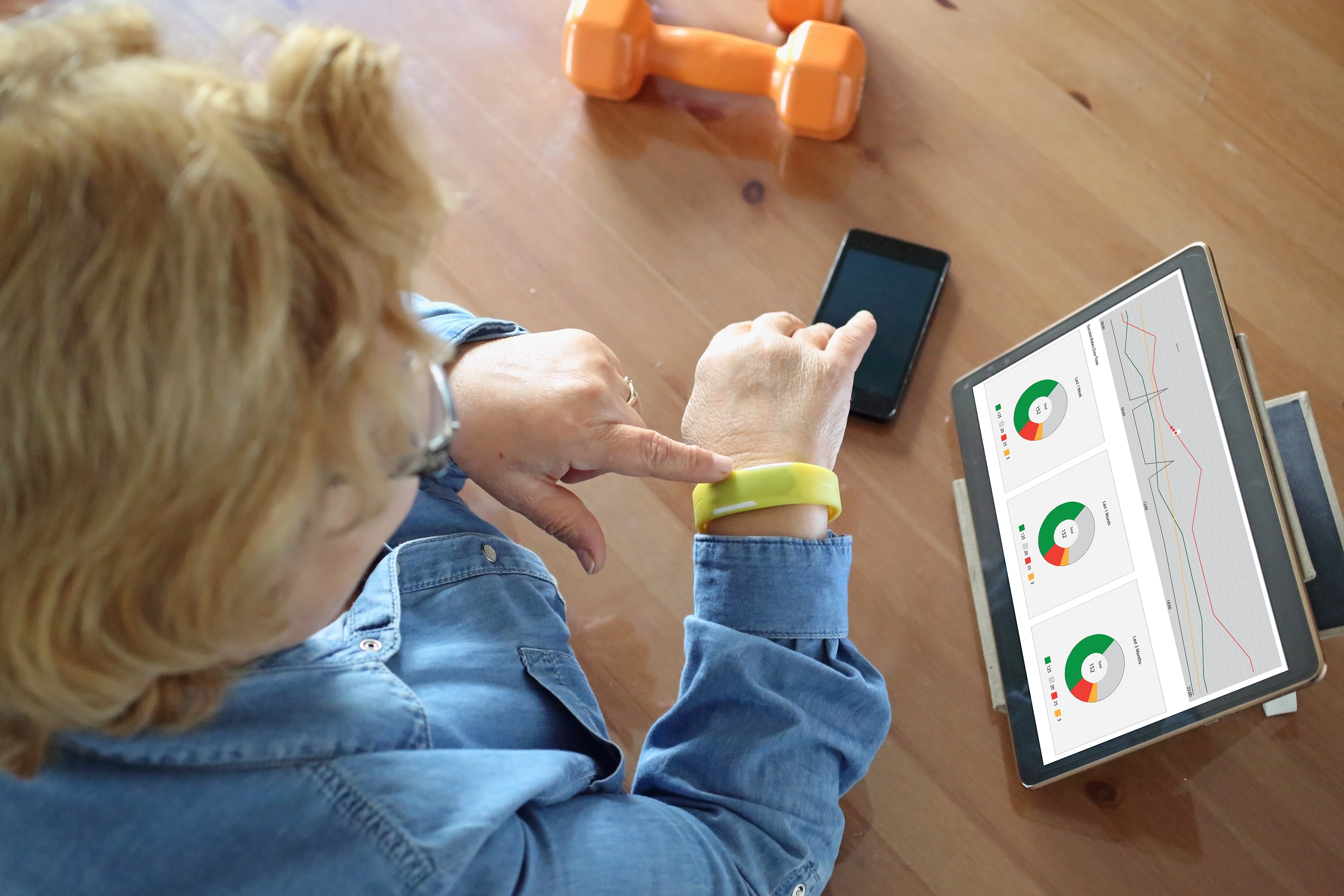Senior woman using fitness tracking device
